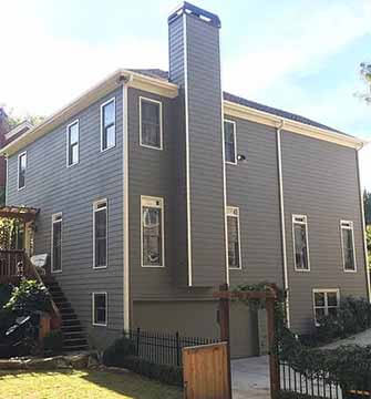 Exterior house painting project with siding, deck and all trim work weatherized